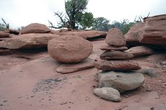 Sandstone Shinto. Stacked stones in a natural red sandstone environment Royalty Free Stock Photo