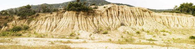 Sandstone slope with erosion. Panoramic view, Sitonia, Greece Stock Photography