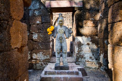 Sandstone statue of god Khmer Art at ancient thai castle or Pras Stock Photography