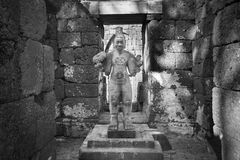 Sandstone statue of god Khmer Art at ancient thai castle or Pras Stock Images