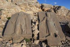 Sandstone Steles on the western platform at Mt Nemrut, Turkey. Stock Images