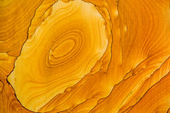 Sandstone texture. Yellow, orange color, rings in stone Stock Photos