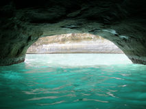 Sandstone Tunnel in Sea, Sidari. A sandstone tunnel/cave at Sidari, Corfu, Greece Royalty Free Stock Photography
