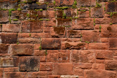 Sandstone Wall. Large expanse of Roman sandstone block wall with moss growing between the blocks for background Stock Photo