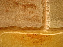 Sandstone Wall Background. Macro abstract photograph taken from a section of a building built with sandstone blocks stock images