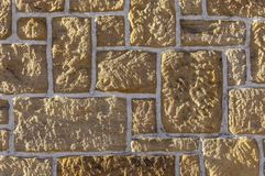 Sandstone wall, bricked with different sized sharpened rustic stone and white joints. For background stock photography