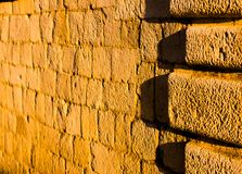 Sandstone wall illuminated by sunset. stock photos