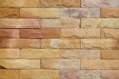 Sandstone wall texture. Closeup for background Stock Image