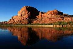 Sandstone and Water. Landscape view of red rock formation along Colorado River in desert southwest in early morning stock photos
