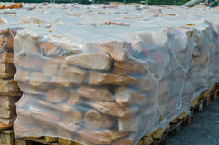 Sandstones on pallet. Dry-stone from German sandstone on a pallet ready for processing Stock Image