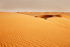 Sandstorm coming over the Arabian desert Stock Images