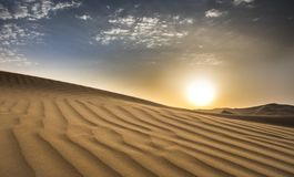 Sandstorm in a desert royalty free stock photos