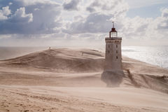 Sandstorm at the lighthouse Stock Photos