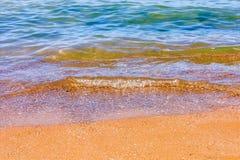 Sandstrand und -welle Lizenzfreie Stockbilder