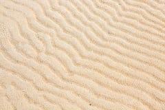 Sandtextur- och bakgrundscloseup arkivbild