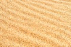 Sandtextur på stranden Arkivfoton