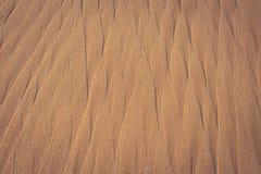Sandtextur som en bakgrund Royaltyfria Foton