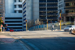 Sandton. People walk down the road early in the morning in Sandton. Sandton CBD in Johannesburg South Africa is a fast growing financial centre not far from the royalty free stock image