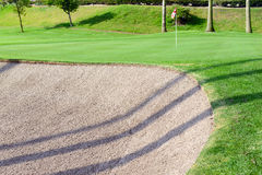 Sandtrap and Manicured grass of golf course Stock Images