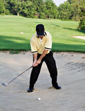 Sandtrap shot. Man hitting ball out of sand trap - golfing stock photos