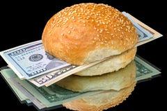 Sanduíche com dólares no preto Foto de Stock Royalty Free
