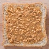 Sanduíche da manteiga de amendoim no fundo de madeira Fotografia de Stock