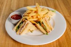 Sanduíche de clube com fritadas francesas Fotografia de Stock Royalty Free