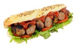 Sanduíche do rolo do sub da salsicha e da salada Imagem de Stock Royalty Free