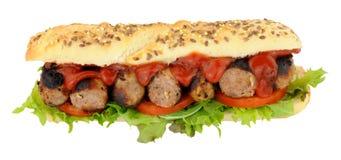 Sanduíche do rolo do sub da salsicha e da salada Imagem de Stock