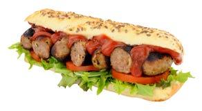 Sanduíche do rolo do sub da salsicha e da salada Foto de Stock Royalty Free