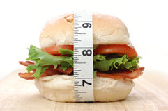 Sanduíche e fita de medição fotos de stock