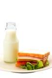 Sanduíche e leite fresco no fundo branco Foto de Stock Royalty Free