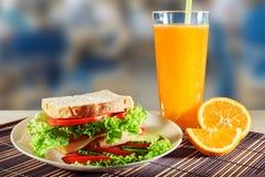 Sanduíche e sumo de laranja Imagem de Stock Royalty Free