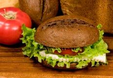 Sanduíche e tomate Fotografia de Stock