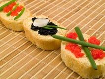 Sanduíches com caviar Imagem de Stock