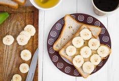 Sanduíches da banana com mel no close-up Foto de Stock