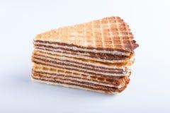 Sanduíches do waffle com o leite condensado fervido isolado no fundo branco imagem de stock