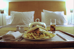 Hotel bed and dinner Stock Images