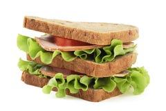 Sanduíche grande com pão marrom no fundo branco Fotografia de Stock Royalty Free