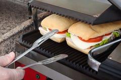 Sanduíches brindados saborosos do cozinheiro Fotos de Stock
