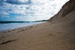 Sandvägg på stranden Arkivfoto