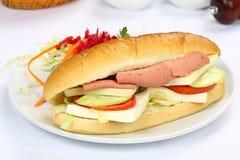 Sandwich à baguette avec du jambon et le fromage Photographie stock