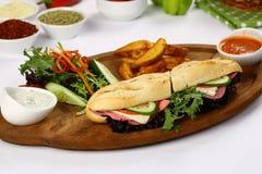 Sandwich à baguette avec du jambon et le fromage Photos libres de droits