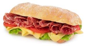 Sandwich à ciabatta avec de la laitue, les tomates prosciutto et le fromage d'isolement sur le fond blanc image stock