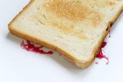 Sandwich à la confiture tombé photographie stock libre de droits