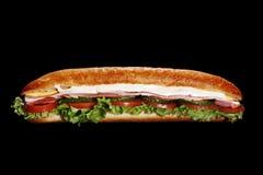 Sandwich à submarin de jambon sur le noir Images stock