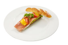 Sandwich. Delicious prosciutto sandwich on white plate Royalty Free Stock Photo