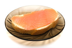Sandwich. Sandwich with red fish on a dark transparent saucer Royalty Free Stock Image