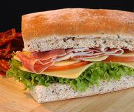 Sandwich. Prosciutto sandwich with cheese and vegetables Stock Photos