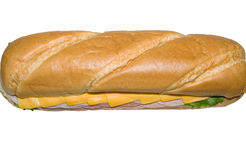 Sandwich. A horizontal picture of a large sub sandwich with meat, cheese slices and lettuce from taken from above it on an isolated white background stock photos